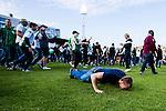 Stockholm 2013-06-23 Fotboll Superettan , Hammarby IF - &Auml;ngelholms FF :  <br /> Hammarby supporter kysser gr&auml;smattan efter att sista matchen p&aring; S&ouml;derstadion mellan Hammarby och &Auml;ngelholm spelats klart. <br /> (Foto: Kenta J&ouml;nsson) Nyckelord:  supporter fans publik supporters
