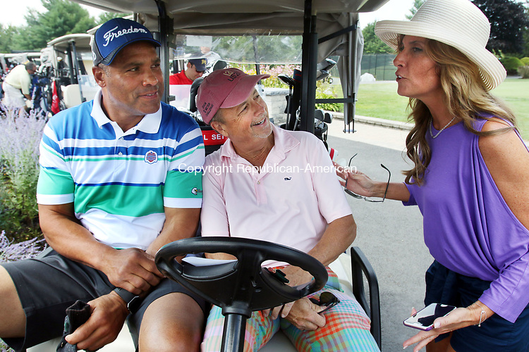 BRISTOL CT. 27 July 2017-080317SV02-From left, Former NFL player, Art Still and Steve Toner of Fairfield talk with Becky Rutrough of Safe Haven during the start for the Safe Haven of Greater Waterbury Golf Tournament at Chippanee Country Club in Bristol Thursday.<br /> Steven Valenti Republican-American