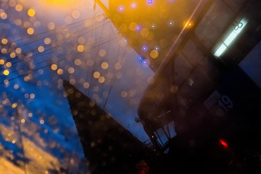 A traffic jam is seen through a rainy car window during the twilight in Quito, Ecuador, 12 November 2012.