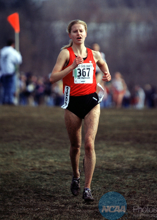 Caption: 22 NOV 1997: Malgorzata Biela (367) of Lewis University placed second with a time of 17:37.7 in the 1997 Men's and Women's Division 2 Cross Country Championship held at Parkside National Cross Country Course on the University of Wisconsin, Parkside campus in Parkside, WI. The women of Lewis University placed first through third in the 5K event. Peter Zuzga/NCAA Photos