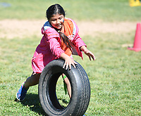 NWA Democrat-Gazette/J.T. WAMPLER Second grader Minerva Gamez (CQ) rolls a tire Thursday May 25, 2017 during Field Day at Frank Tillery Elementary School in Rogers. Today (FRIDAY MAY 26) is the last day of school for the Rogers school district.