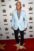 LOS ANGELES - FEB 29:  Greg Louganis at the Beverly Hills Dog Show Presented by Purina at the LA County Fairplex on February 29, 2020 in Pomona, CA