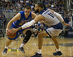 South Dakota State guard Owen King (23) is stoped by Nevada's Cody Martin (11) in the second half of an NCAA college basketball game in Reno, Nev., Saturday, Dec. 15, 2018. (AP Photo/Tom R. Smedes)