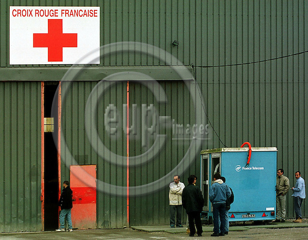 FRANCE / SANGATTE 16, MARCH 2001--The French Red Cross refurgee centre close to Calais, was founded in Septembre 1999 due to the growing amount of refugees in the central park of Calais, trying to cross the channel to Great Britain. Since then more than 26 000 refugees from 104 countries have passed through the former Channel Tunel construction warehouse. --PHOTO: JUHA ROININEN / EUP-IMAGES