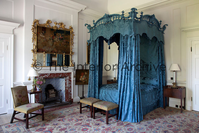 A grand Thomas Chippendale four-poster bed, newly furnished in blue silk damask, in the state bedroom
