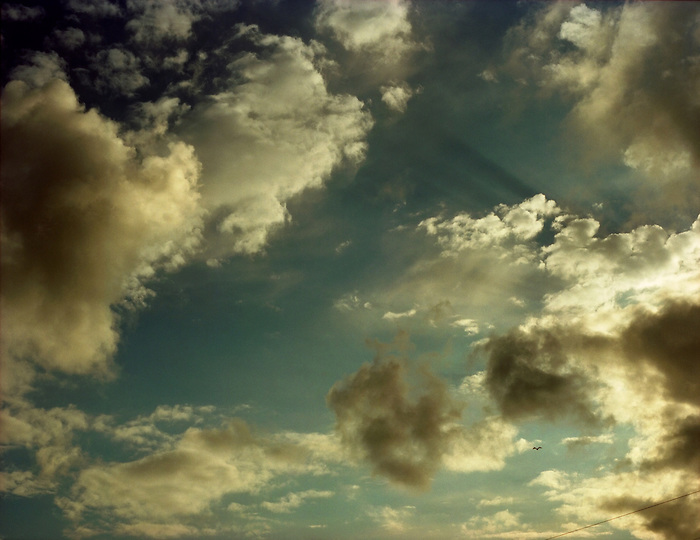 Sun through clouds, evening.