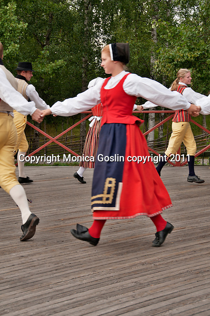 Folk dancers perform traditional dances at Skansen in Stockholm, the outdoor museum of traditional Swedish buildings and farmsteads