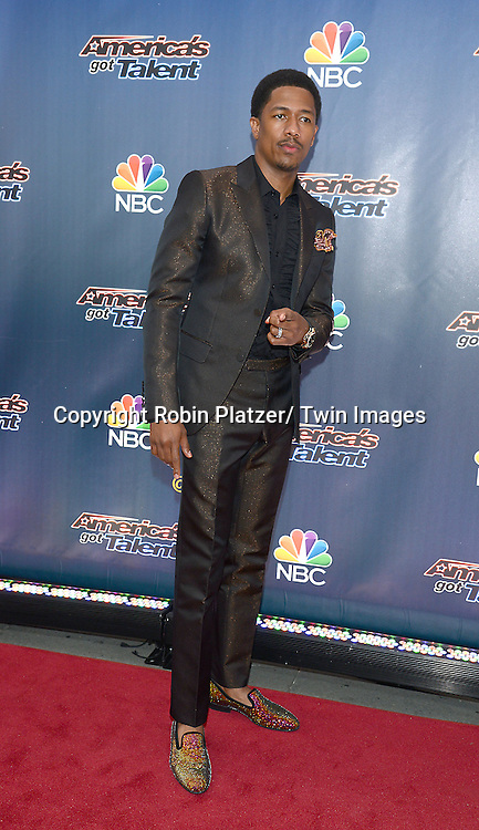 """Nick Cannon attends the kick off  of Season 9's live voting rounds of """"America's Got Talent""""  at Radio City Music Hall on July 29, 2014 in New York City."""