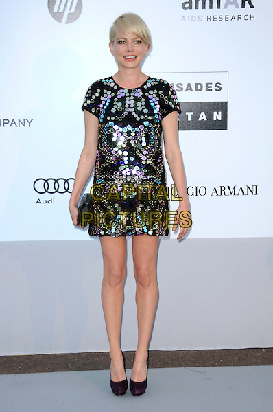 MICHELLE WILLIAMS.arrivals at amfAR's Cinema Against AIDS 2010 benefit gala at the Hotel du Cap, Antibes, Cannes, France during the Cannes Film Festival.20th May 2010.amfAR full length black dress mini paillettes discs purple shoes sequined sequin gold blue platform clutch bag .CAP/CAS.©Bob Cass/Capital Pictures.