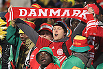 19 JUN 2010:  Denmark fan within the Cameroon section in the stands.  The Cameroon National Team played the Denmark National Team at Loftus Versfeld Stadium in Tshwane/Pretoria, South Africa in a 2010 FIFA World Cup Group E match.