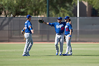 Los Angeles Dodgers outfielders Andy Pages (65), Drew Avans (26), and Andrew Shaps (27) celebrate a victory after an Instructional League game against the Milwaukee Brewers at Maryvale Baseball Park on September 24, 2018 in Phoenix, Arizona. (Zachary Lucy/Four Seam Images)