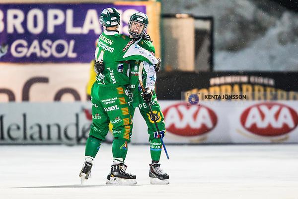 Stockholm 2014-02-21 Bandy SM-kvartsfinal 3 Hammarby IF - Vetlanda BK :  <br /> Hammarbys Jesper Jonsson jublar med Hammarbys Anders Persson efter sitt 2-1 m&aring;l<br /> (Foto: Kenta J&ouml;nsson) Nyckelord: jubel gl&auml;dje lycka glad happy