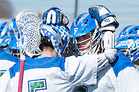 Teammates Alex Makoske,'18, left, and Frank Russo,'16, embrace as the Seahawks face Endicott in Men's Lacrosse game action at Gaudet Field in Middletown.