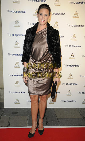 KAREN PICKERING .Activate Sport Foundation Launch Dinner - outside arrivals, Banqueting House, Whitehall Place, London, England, UK, October 31st 2010..full length black shoes brown silk satin dress clutch bag fur cropped bolero jacket .CAP/CAN.©Can Nguyen/Capital Pictures.
