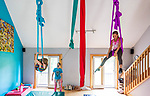 HARWINTON , CT-080620JS11—Instructor Becca DeAngelis, center, looks on as Leah Reeves, 10 of Terryville, left, and Aurelia Gemino, 14, of Harwinton, works an their aerial sling hammock routine during the Thrive Movement Studio's circus camp Thursday at their studio in Harwinton. <br />  Jim Shannon Republican-American