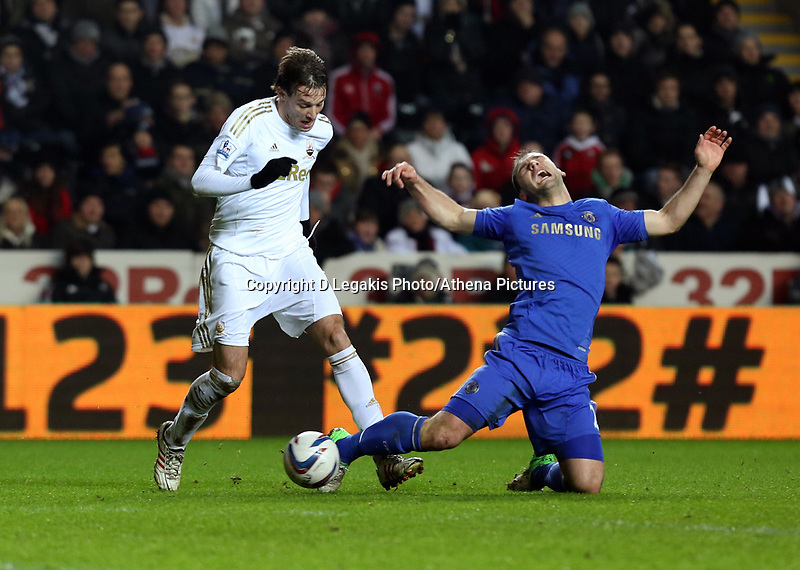 Wednesday 23 January 2013<br /> Pictured: (L-R) Michu of Swansea and Branislav Ivanovic of Chelsea.<br /> Re: Capital One Cup semi-final second leg, Swansea City FC v Chelsea at the Liberty Stadium, south Wales.