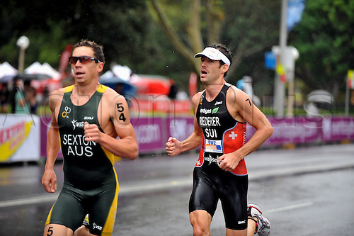 10.04.2011 Dextro Energy Triathlon from Sydney Australia.Third place getter Sven Riederer (SUI) following fourth place Brendan Sexton (AUS)