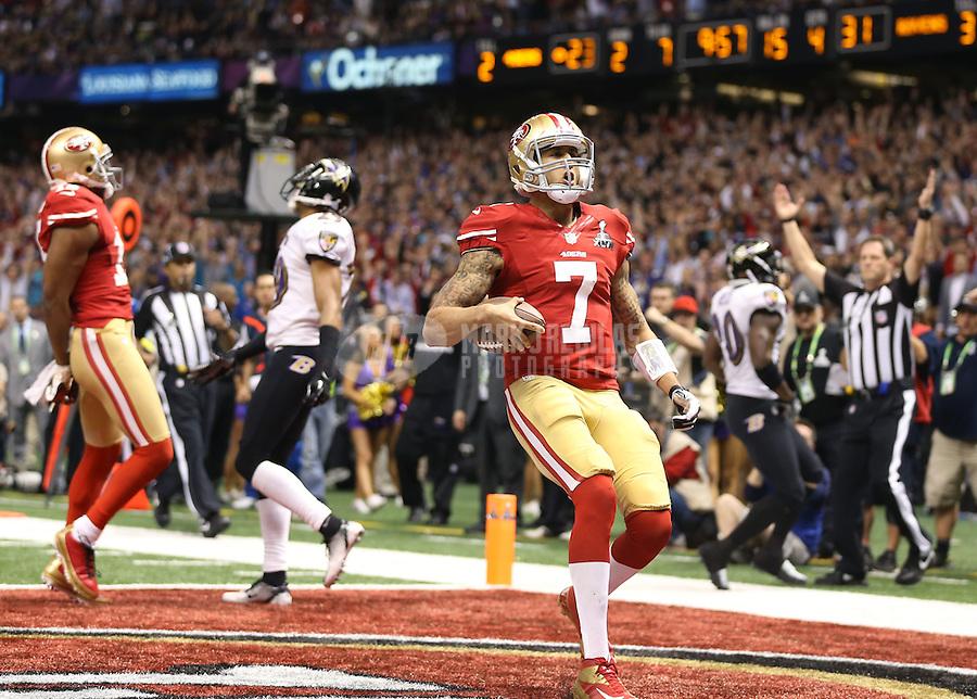 Feb 3, 2013; New Orleans, LA, USA; San Francisco 49ers quarterback Colin Kaepernick (7) celebrates after scoring a touchdown against the Baltimore Ravens in the fourth quarter in Super Bowl XLVII at the Mercedes-Benz Superdome. Mandatory Credit: Mark J. Rebilas-
