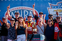 Sep 2, 2019; Clermont, IN, USA; NHRA top fuel driver Doug Kalitta celebrates with family and crew after winning the US Nationals at Lucas Oil Raceway. Mandatory Credit: Mark J. Rebilas-USA TODAY Sports