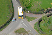 Shool bus on a country crossroad taken from Beeston Castle.