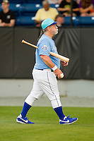 """""""Batboy"""" Randy Fruth performs his duties during the Appalachian League game between the Pulaski Mariners and the Burlington Royals at Burlington Athletic Park on June20 2013 in Burlington, North Carolina.  The Royals defeated the Mariners 2-1 in 13 innings.  (Brian Westerholt/Four Seam Images)"""