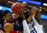 PITTSBURGH, PA - MARCH 21:  Kyle Washington #32 of the North Carolina State Wolfpack and Daniel Ochefu #23 of the Villanova Wildcats go after the ball in the first half during the third round of the 2015 NCAA Men's Basketball Tournament at Consol Energy Center on March 21, 2015 in Pittsburgh, Pennsylvania.  (Photo by Jared Wickerham/Getty Images)