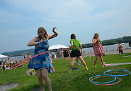 July 3, 2011 (Washington, DC)  These young ladies hula hoop at the National Freedom Fest, the DC areas largest Fourth of July Festival, kicked off July 3rd.  The two day event featured 40 bands and DJs on 5 stages, with food and fun for everyone.  (Photo: Don Baxter/Media Images International)