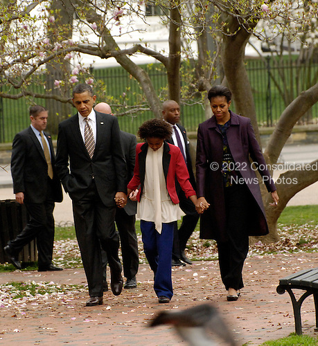 United States President Barack Obama, First Lady Michelle Obama and daughter Sasha Obama walk across Lafayette Park on their way to services at St. John's Church, on Sunday, March 18, 2012, in Washington, DC.  .Credit: Leslie E. Kossoff / Pool via CNP
