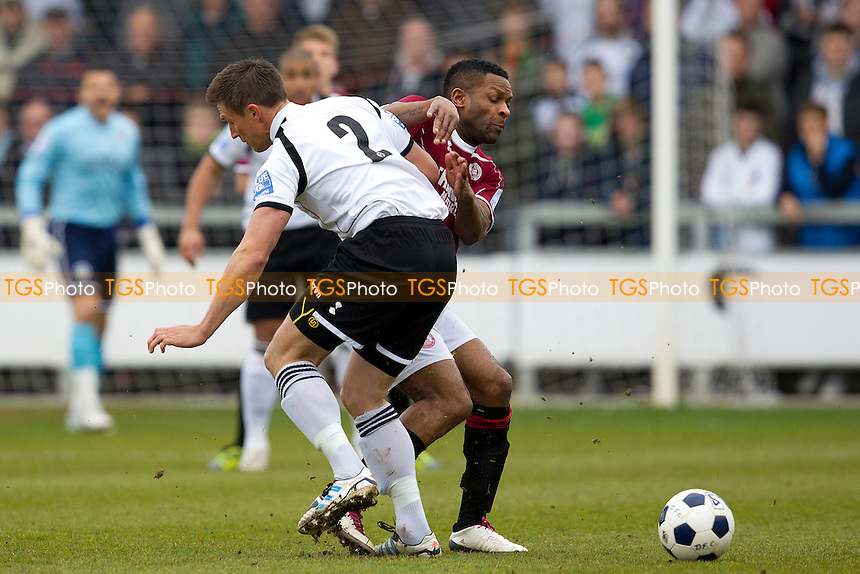 Lee Burns of Dartford Town and Kezie Ibe (Chelmsford City) tussle for the ball - Dartford vs Chelmsford City - Blue Square Conference South Football at Princes Park - 07/04/12 - MANDATORY CREDIT: Ray Lawrence/TGSPHOTO - Self billing applies where appropriate - 0845 094 6026 - contact@tgsphoto.co.uk - NO UNPAID USE.