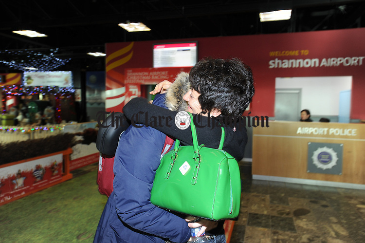 Charlie Cooper is welcomed home by his mother Nora after arriving on the Heathrow to Shannon flight on Tuesday afternoon. Photograph by John Kelly.