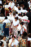 Kimono-clad 20-year-old Japanese women await the start of a ceremony held for Coming-of-Age Day at Toshimaen amusement park in Tokyo, Japan. While Japanese women can marry as early as 16 years of age and men at 18, neither is considered to reach adulthood until they reach 20, when they can also legally begin to smoke, drink and vote.ey can also legally begin to smoke, drink and vote.
