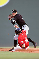 Second baseman Zach Remillard (8) of the Kannapolis Intimidators turns a double play as Steven Reveles (18) of the Greenville Drive is out in a game on Friday, July 14, 2017, at Fluor Field at the West End in Greenville, South Carolina. Greenville won, 2-0. (Tom Priddy/Four Seam Images)