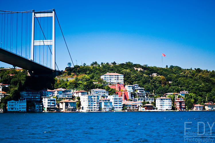 View of the house built near  one of the bridges crossing the Bosphorus, Istanbul (Turkey)