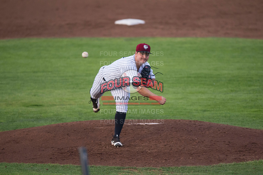 Idaho Falls Chukars starting pitcher Jon Heasley (51) follows through on his delivery during a Pioneer League game against the Great Falls Voyagers at Melaleuca Field on August 18, 2018 in Idaho Falls, Idaho. The Idaho Falls Chukars defeated the Great Falls Voyagers by a score of 6-5. (Zachary Lucy/Four Seam Images)