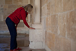 Pam Sparks touches one of the 12th century stones from the Chapter House of Ovila in Spain used to build the Chapter House at the New Clairvaux monastery in Vina, Calif., January 2, 2013. The stones were purchased by William Randolph Hearst, but then left abandoned in Golden Gate Park for over 60 years.