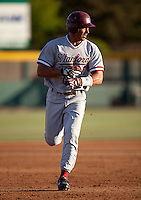 STOCKTON, CA - May 9, 2011: Tyler Gaffney of Stanford baseball removes his batting gloves as he rounds third after hitting a homerun during Stanford's game against Pacific at Klein Family Field in Stockton. Stanford won 11-5.