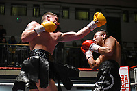 Dylan Moran (yellow gloves) defeats Oscar Amador during a Boxing Show at York Hall on 2nd February 2019
