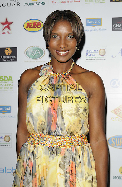 Denise Lewis .attended the World Food Awards 2011, Grosvenor House hotel, Park Lane, London, England, UK, 1st October 2011..half length  yellow print dress halterneck  .CAP/CAN.©Can Nguyen/Capital Pictures.