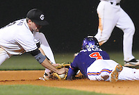 Second baseman Scott Wingo (8) of the South Carolina Gamecocks shows the ball to the umpire to prove he tagged out John Hinson (4) of the Clemson Tigers in the seventh inning on Tuesday, March 8, 2011, at Fluor Field in Greenville, S.C. South Carolina won 5-4. Photo by Tom Priddy / Four Seam Images