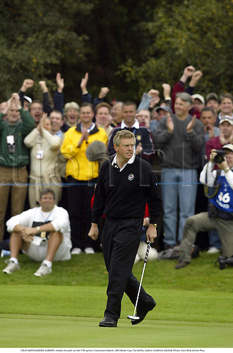 COLIN MONTGOMERIE (EUROPE)  makes his putt on the 17th green, Foursomes Match, 34th Ryder Cup, The Belfry, Sutton Coldfield, 020928. Photo: Glyn Kirk/Action Plus....2002.golf golfer player.putts putting...... .....