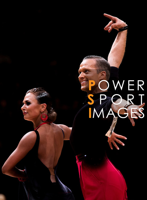 Dmitri Pugachev and Daria Glukhova of Russia during the WDSF GrandSlam Latin on the Day 1 of the WDSF GrandSlam Hong Kong 2014 on May 31, 2014 at the Queen Elizabeth Stadium Arena in Hong Kong, China. Photo by AItor Alcalde / Power Sport Images