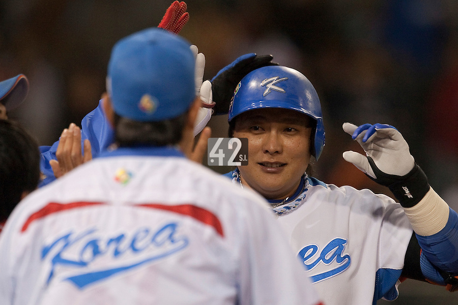 15 March 2009: #52 Tae Kyun Kim of Korea is congratulated by teammates after scoring an homerun during the 2009 World Baseball Classic Pool 1 game 2 at Petco Park in San Diego, California, USA. Korea wins 8-2 over Mexico.