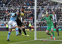 30th November 2019; St James Park, Newcastle, Tyne and Wear, England; English Premier League Football, Newcastle United versus Manchester City; Gabriel Jesus of Manchester City heads wide with Paul Dummett of Newcastle United challenging and Martin Dubravka of Newcastle United covering - Strictly Editorial Use Only. No use with unauthorized audio, video, data, fixture lists, club/league logos or 'live' services. Online in-match use limited to 120 images, no video emulation. No use in betting, games or single club/league/player publications