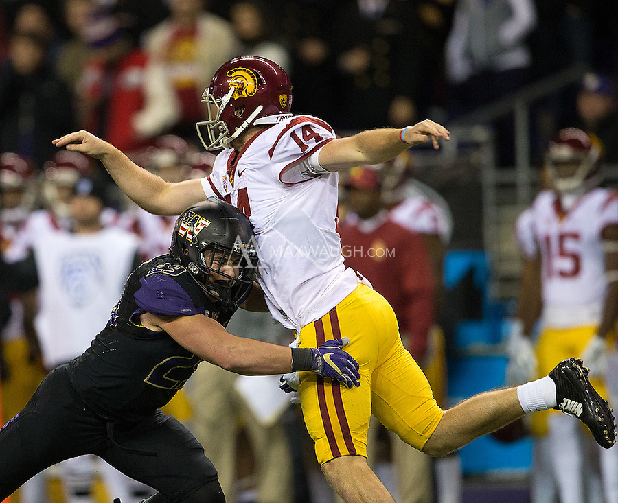 Trojan quarterback Sam Darnold was dancing away from the Husky defense all night long.