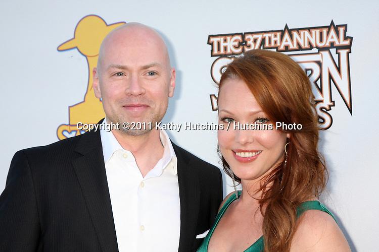 LOS ANGELES - JUN 23:  Steven DeKnight, Erin Cummings arriving at the 2011 Saturn Awards  at Castaways on June 23, 2011 in Burbank, CA