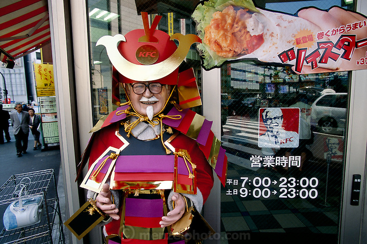 A Japanese Colonel Sanders adorns a KFC in Tokyo, Japan. (From a photographic gallery of images of fast food, in Hungry Planet: What the World Eats, p. 94)