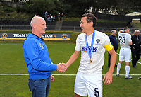 Auckland City FC board member Colin Cook (left) shakes hands with Auckland captain Angel Berlanga after the Oceania Football Championship final (second leg) football match between Team Wellington and Auckland City FC at David Farrington Park in Wellington, New Zealand on Sunday, 7 May 2017. Photo: Dave Lintott / lintottphoto.co.nz