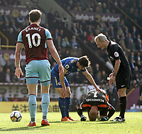 Leicester City's Kasper Schmeichel is injured by Burnley's Ashley Barnes who was shown a yellow card by Referee Martin Atkinson for the challenge<br /> <br /> Photographer Rich Linley/CameraSport<br /> <br /> The Premier League - Burnley v Leicester City - Saturday 14th April 2018 - Turf Moor - Burnley<br /> <br /> World Copyright &copy; 2018 CameraSport. All rights reserved. 43 Linden Ave. Countesthorpe. Leicester. England. LE8 5PG - Tel: +44 (0) 116 277 4147 - admin@camerasport.com - www.camerasport.com