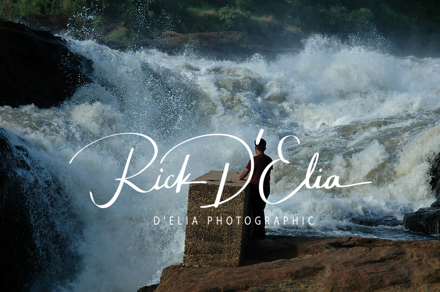 Tourists study the power of the Victoria Nile as it thunders through Murcheson Falls in Murcheson Falls National Park in northwestern Uganda. (Rick D'Elia)