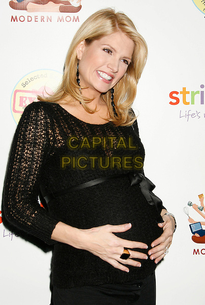 DAYNA DEVON.The Modern Mom Mingle held at the Skybar at Mondrian, .West Hollywood, California, USA, 30 November 2006..half length black dress pregnant hand on tummy bump.CAP/ADM/RE.©Russ Elliot/AdMedia/Capital Pictures.